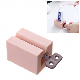 Toothpaste Dispenser Rolling Holder Plastic Rolling Tube Toothpaste Squeezer - Pink